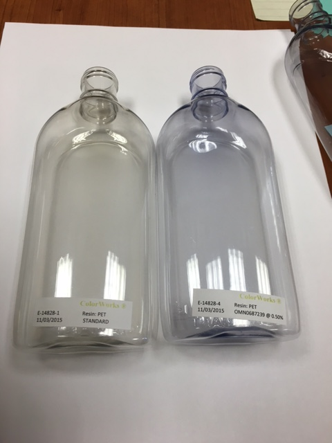 The uncolored PET bottle on the left was made using 25% PCR while the one on the right has the same ...