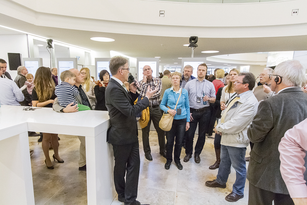 Helmut Müller, architect and project manager of the Clariant Innovation Center, outlining the architectural highlights of the building at the end of a guided tour.