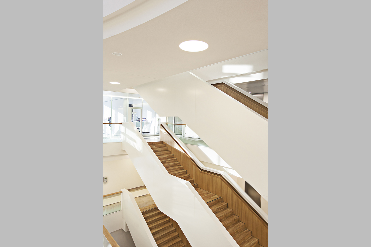 All floors are connected by the centrally located, open staircase that fits seamlessly into the overall structure of the building.