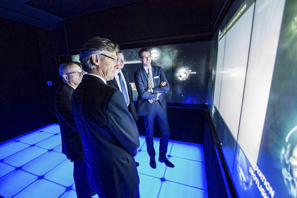 Guests discovering the multimedia exhibition »In Touch with Clariant«.